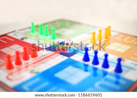 Picture of family ludo board  game.