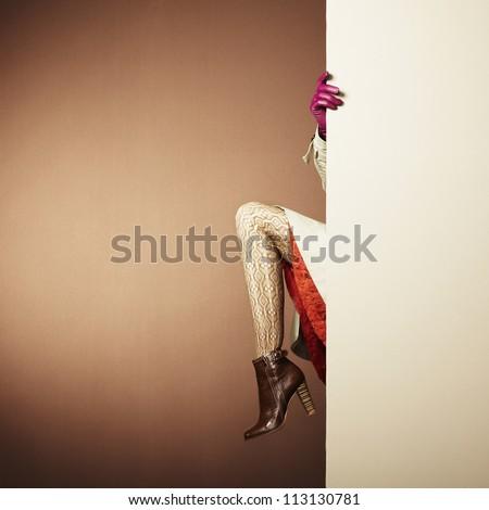 Picture of female legs in the interior. Conceptual fashion photo