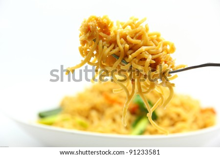 picture of fried noodles with vegetables on white background.