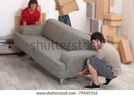 picture of friends moving a couch