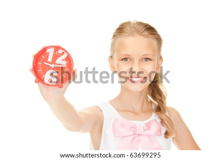 picture of girl holding alarm clock over white