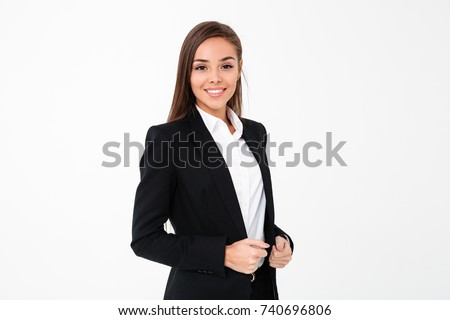 Picture of gorgeous cheerful business woman standing isolated over white background. Looking camera.