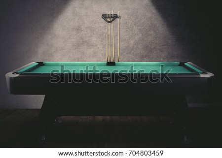 Picture of green billiard table with sticks. shot in the billiard room