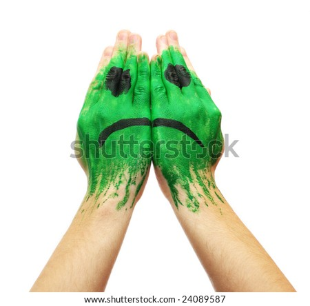 Picture of  Green sad smile mask painted on male hands isolated on white background