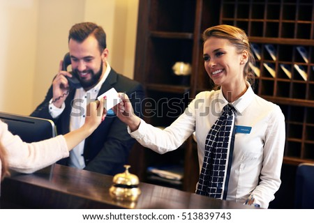 Picture of guests getting key card in hotel #513839743