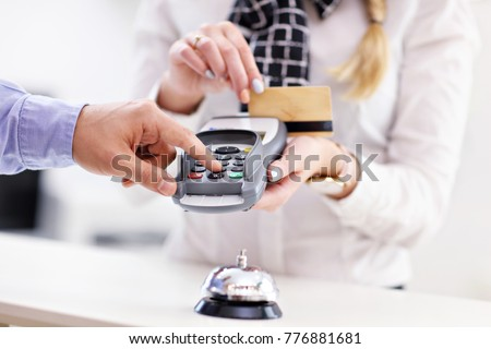Picture of guests paying for hotel