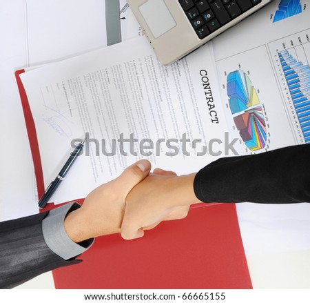 picture of handshake two business partners, when signing contract.