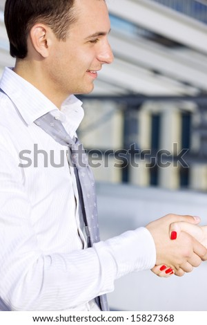 picture of handsome businessman shaking hands with female colleague