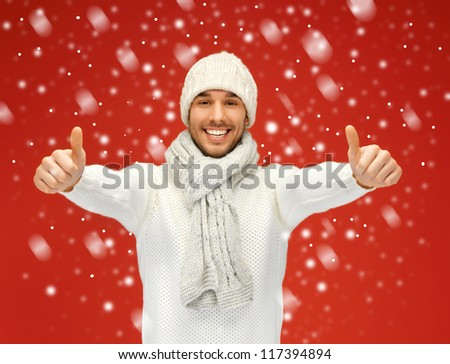picture of handsome man in warm sweater with snow