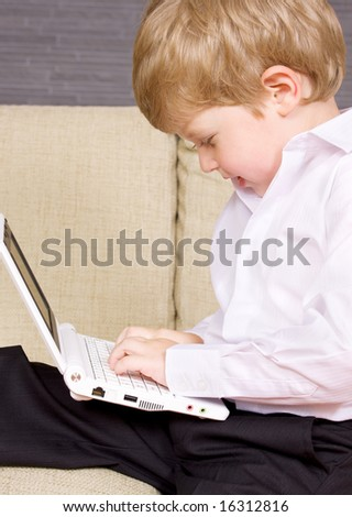 picture of happy boy with white laptop computer