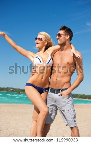 picture of happy couple in sunglasses on the beach. - stock photo