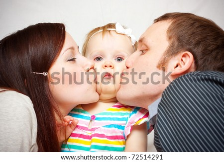 picture of happy family with baby over white