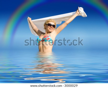 picture of happy girl with towel standing in water
