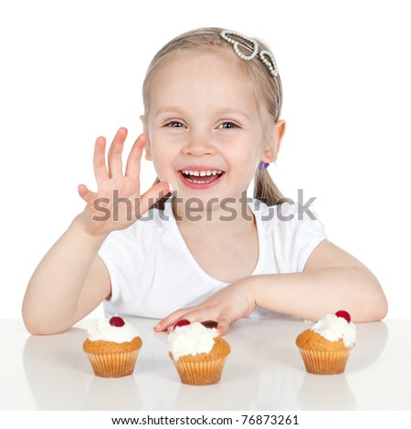 Picture of happy little girl eating cake isolated on white background