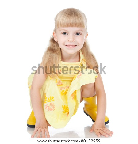 Picture of happy little girl in the yellow boots over white