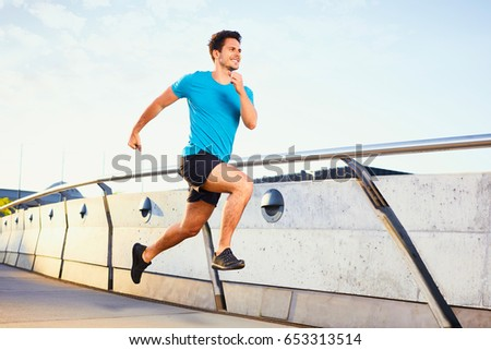 Picture of happy man running on bridge #653313514