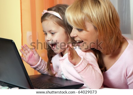 picture of happy mother and child with laptop computer