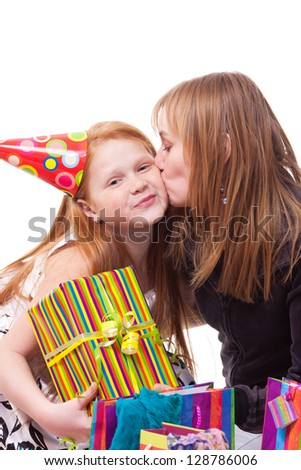 picture of happy mother and daughter with gift box