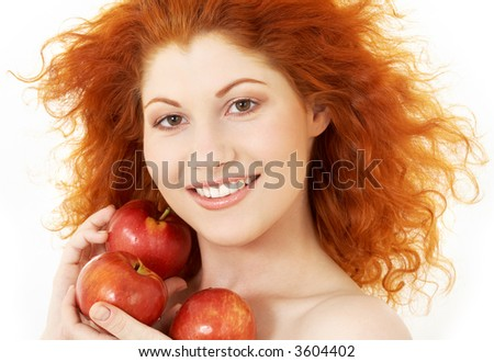 picture of happy redhead with red apples