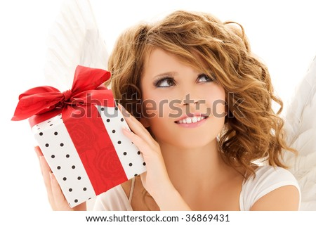 picture of happy teenage angel girl with gift over white