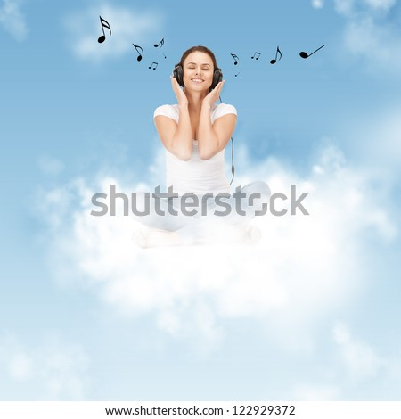 picture of happy teenage girl in big headphones sitting on cloud