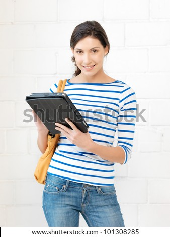 picture of happy teenage girl with tablet pc computer