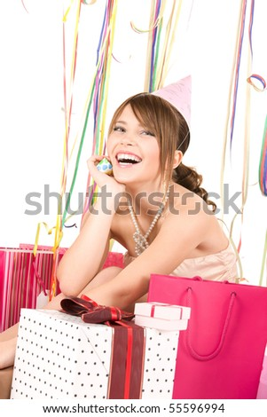 picture of happy teenage party girl with gifts