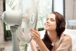 picture of happy woman with big fan