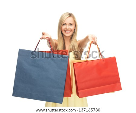 picture of happy woman with shopping bags .