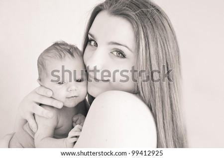 picture of happy young mother with newborn baby