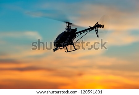 Picture of helicopter at sunset