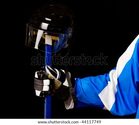 Picture of hockey helmet  and stick