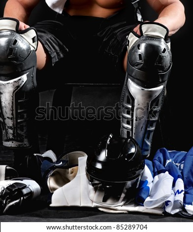 Picture of hockey player after game sitting in locker room