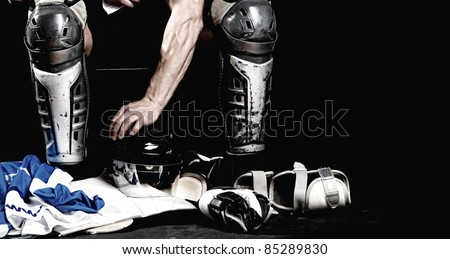 Picture of hockey player after game sitting in locker room - stock photo