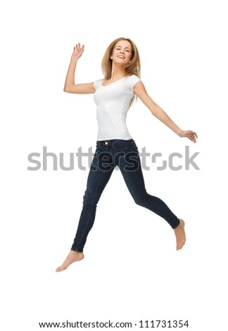 picture of jumping teenage girl in blank white t-shirt - stock photo
