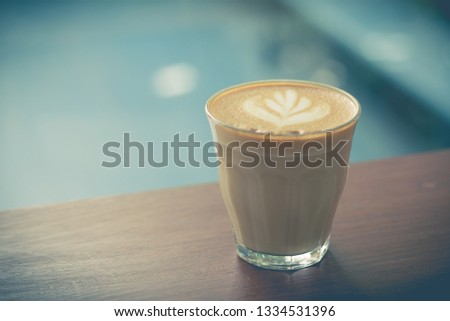 Picture of  latte or cappuccino coffee with latte art on a wooden table #1334531396