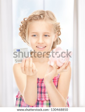 picture of little girl with piggy bank and money