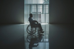Picture of lonely elderly man looks sad in the retirement home while sitting in the wheelchair