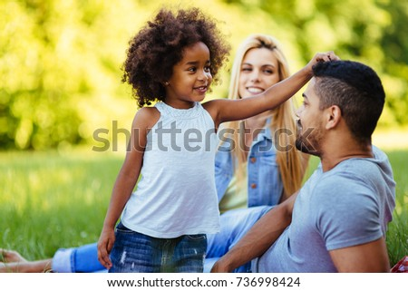 Picture of lovely couple with their daughter having picnic #736998424