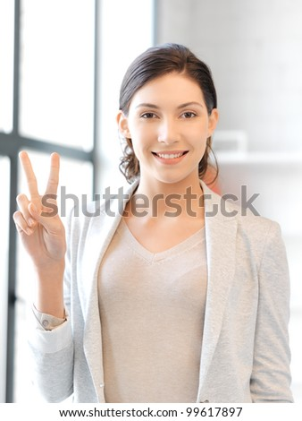 picture of lovely teenage girl showing victory or peace sign