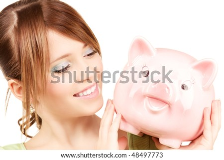picture of lovely teenage girl with piggy bank