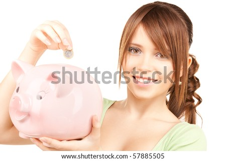 picture of lovely teenage girl with piggy bank and coin
