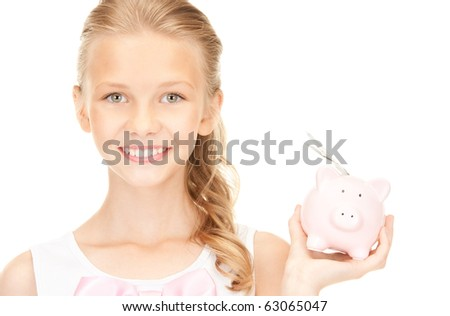 picture of lovely teenage girl with piggy bank and money
