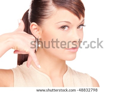 picture of lovely woman making a call me gesture