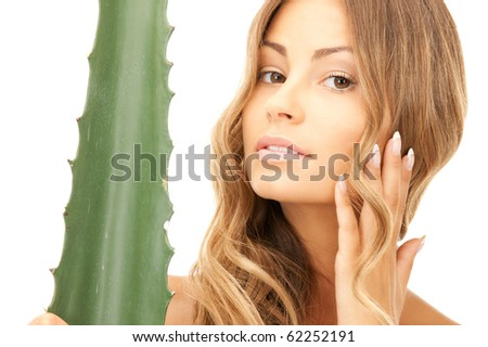 picture of lovely woman with aloe vera - stock photo