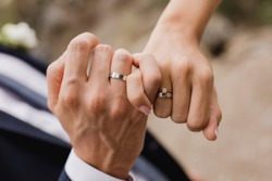 Picture of man and woman with wedding ring.Young married couple holding hands, ceremony wedding day. Newly wed couple's hands with wedding rings.