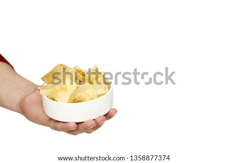 Picture of man hand is holding potato chips in the bowl. Isolated on the white background.