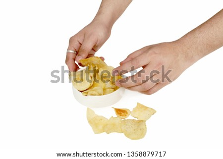 Picture of man hand is picking chips. Isolated on the white background.