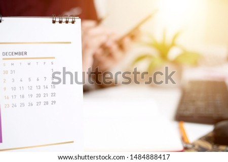 Picture of Man holding Calendar. Isolated on white background.