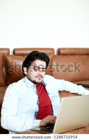 Picture of man is using laptop.